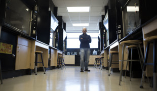Rico stands in the lab at Dixie State University.
