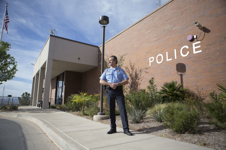 Chief Stratton stands in front of the St. George police department building. He became interim chief in 2000. The position became permanent later that year.