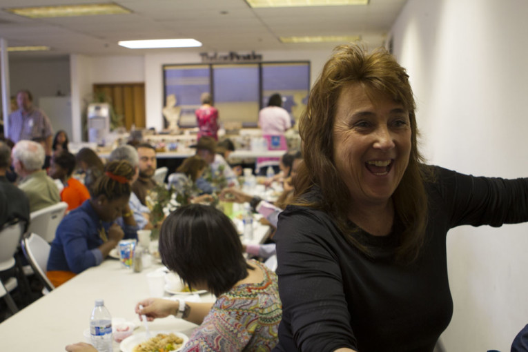 Rickine welcomes community members to the Sunday feast. She says she loves giving people a place where they can belong.